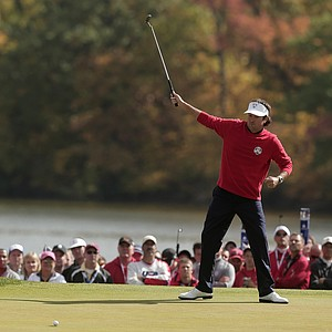 USA's Bubba Watson reacts as he makes a putt on the first hole during a singles match at the Ryder Cup PGA golf tournament Sunday, Sept. 30, 2012, at the Medinah Country Club in Medinah, Ill.