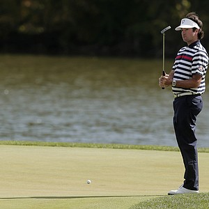 USA's Bubba Watson reacts after missing a putt on the second hole during a singles match at the Ryder Cup PGA golf tournament Sunday, Sept. 30, 2012, at the Medinah Country Club in Medinah, Ill.