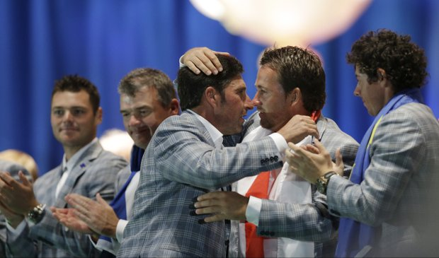 European team captain Jose Maria Olazabal is embraced by Graeme McDowell at the closing ceremony at the Ryder Cup PGA golf tournament Sunday, Sept. 30, 2012, at the Medinah Country Club in Medinah, Ill.