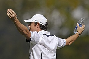 Europe's Rory McIlroy reacts to chants from the crowd on the first tee before a singles match at the Ryder Cup PGA golf tournament Sunday, Sept. 30, 2012, at the Medinah Country Club in Medinah, Ill.