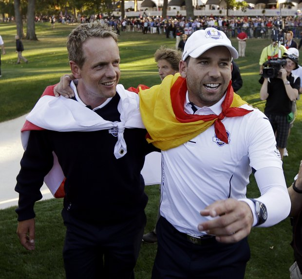 Europe's Sergio Garcia, right, and Luke Donald celebrates after winning the Ryder Cup PGA golf tournament Sunday, Sept. 30, 2012, at the Medinah Country Club in Medinah, Ill.