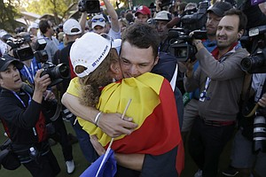 Europe's Martin Kaymer celebrates with Miguel Ángel Jiménez after winning the Ryder Cup PGA golf tournament Sunday, Sept. 30, 2012, at the Medinah Country Club in Medinah, Ill.