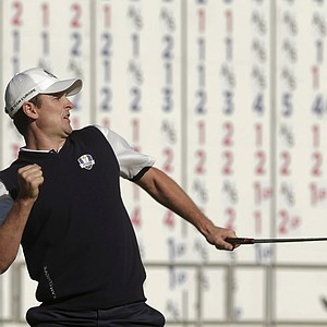Europe's Justin Rose reacts after defeating USA's Phil Mickelson on the 18th hole during a singles match at the Ryder Cup PGA golf tournament Sunday, Sept. 30, 2012, at the Medinah Country Club in Medinah, Ill.