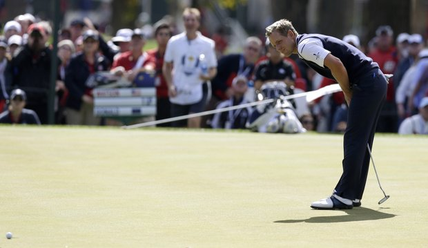 Europe's Luke Donald reacts after missing a birdie putt on the third hole during a singles match at the Ryder Cup PGA golf tournament Sunday, Sept. 30, 2012, at the Medinah Country Club in Medinah, Ill.