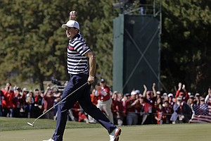 USA's Keegan Bradley reacts after making a birdie putt on the 11th hole during a singles match at the Ryder Cup PGA golf tournament Sunday, Sept. 30, 2012, at the Medinah Country Club in Medinah, Ill.