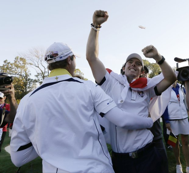 Europe's Rory McIlroy, right, and Nicolas Colsaerts celebrate after winning the Ryder Cup PGA golf tournament Sunday, Sept. 30, 2012, at the Medinah Country Club in Medinah, Ill.