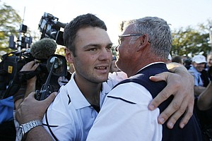 Europe's Martin Kaymer celebrates with Darren Clarke after winning the Ryder Cup PGA golf tournament Sunday, Sept. 30, 2012, at the Medinah Country Club in Medinah, Ill.