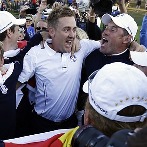 Europe's Luke Donald, Ian Poulter, Lee Westwood and Rory McIlroy celebrate after winning the Ryder Cup PGA golf tournament Sunday, Sept. 30, 2012, at the Medinah Country Club in Medinah, Ill.