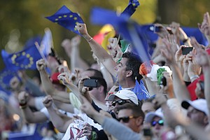 European fan celebrate their comeback win at the Ryder Cup PGA golf tournament Sunday, Sept. 30, 2012, at the Medinah Country Club in Medinah, Ill.