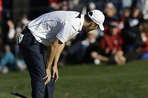 Europe's Martin Kaymer reacts after missing a putt on the 15th hole during a singles match at the Ryder Cup PGA golf tournament Sunday, Sept. 30, 2012, at the Medinah Country Club in Medinah, Ill.