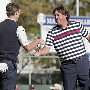 USA's Phil Mickelson, right, congratulates Europe's Justin Rose after a singles match at the Ryder Cup PGA golf tournament Sunday, Sept. 30, 2012, at the Medinah Country Club in Medinah, Ill.