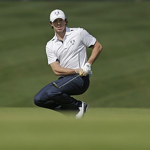 Europe's Rory McIlroy reacts after chipping up to the first green during a singles match at the Ryder Cup PGA golf tournament Sunday, Sept. 30, 2012, at the Medinah Country Club in Medinah, Ill.