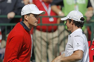 Europe's Rory McIlroy, right, shakes hands with USA's Keegan Bradley before a singles match at the Ryder Cup PGA golf tournament Sunday, Sept. 30, 2012, at the Medinah Country Club in Medinah, Ill.