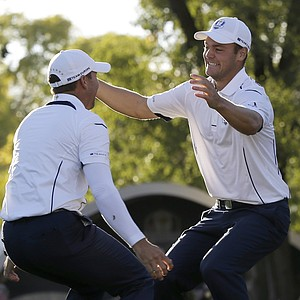 Europe's Martin Kaymer leaps into the arms of teammate Sergio Garcia after winning the Ryder Cup PGA golf tournament Sunday, Sept. 30, 2012, at the Medinah Country Club in Medinah, Ill.