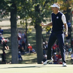 Europe's Ian Poulter reacts after making a putt on the 12th hole during a singles match at the Ryder Cup PGA golf tournament Sunday, Sept. 30, 2012, at the Medinah Country Club in Medinah, Ill.