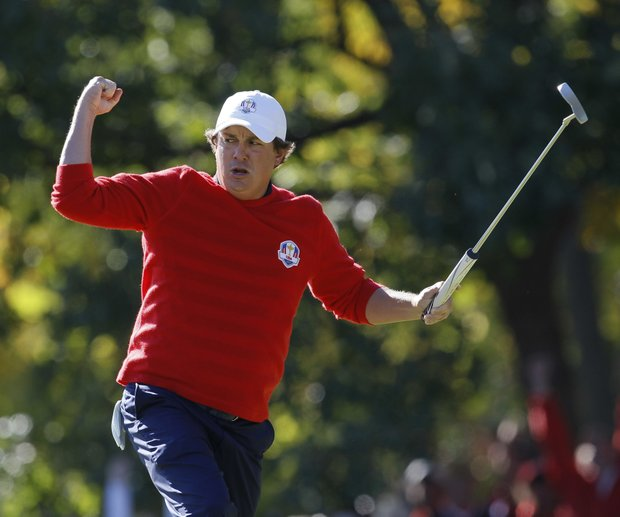 USA's Jason Dufner reacts after making a birdie putt on the 13th hole during a singles match at the Ryder Cup PGA golf tournament Sunday, Sept. 30, 2012, at the Medinah Country Club in Medinah, Ill.