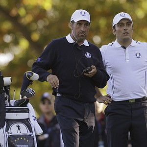 European team captain Jose Maria Olazabal, left, talks to Francesco Molinari on the 17th tee during a singles match at the Ryder Cup PGA golf tournament Sunday, Sept. 30, 2012, at the Medinah Country Club in Medinah, Ill.