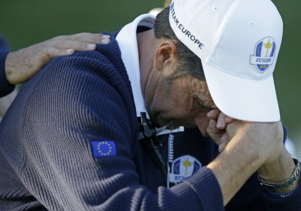 European team captain Jose Maria Olazabal holds his head down on the 17th hole during a singles match at the Ryder Cup PGA golf tournament Sunday, Sept. 30, 2012, at the Medinah Country Club in Medinah, Ill.