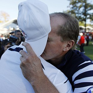 USA's Steve Stricker covers his face as he hugs Europe's Martin Kaymer after a singles match at the Ryder Cup PGA golf tournament Sunday, Sept. 30, 2012, at the Medinah Country Club in Medinah, Ill.