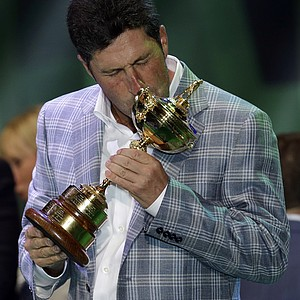 European team captain Jose Maria Olazabal kisses the trophy at the closing ceremony of the Ryder Cup PGA golf tournament Sunday, Sept. 30, 2012, at the Medinah Country Club in Medinah, Ill.