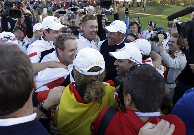 European players celebrate after winning the Ryder Cup PGA golf tournament Sunday, Sept. 30, 2012, at the Medinah Country Club in Medinah, Ill.