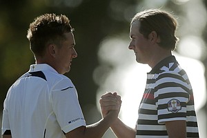 USA's Webb Simpson, right, congratulates Europe's Ian Poulter after their singles match at the Ryder Cup PGA golf tournament Sunday, Sept. 30, 2012, at the Medinah Country Club in Medinah, Ill.