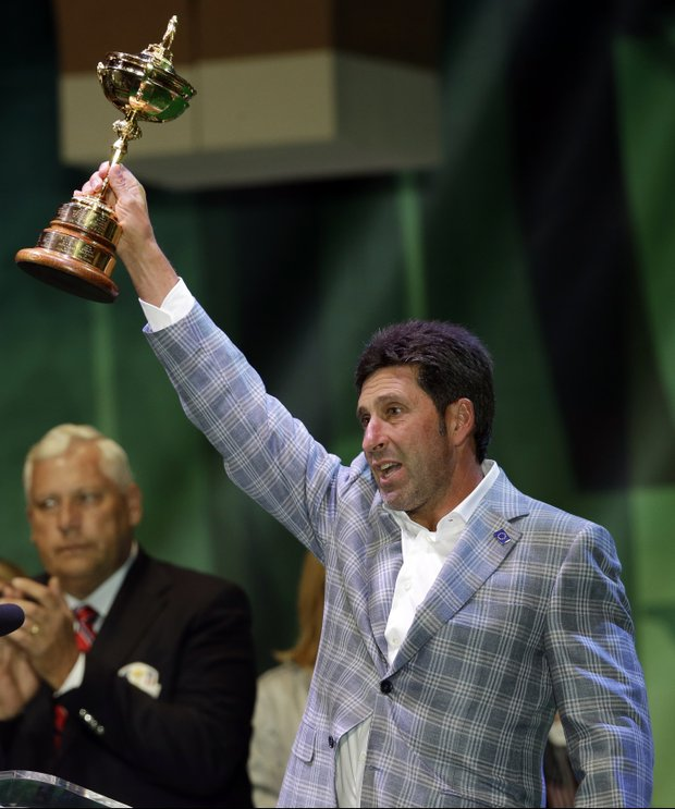 European team captain Jose Maria Olazabal holds up the trophy at the closing ceremony of the Ryder Cup PGA golf tournament Sunday, Sept. 30, 2012, at the Medinah Country Club in Medinah, Ill.