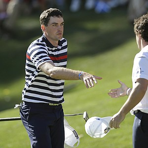 USA's Keegan Bradley congratulates Europe's Rory McIlroy after their singles match at the Ryder Cup PGA golf tournament Sunday, Sept. 30, 2012, at the Medinah Country Club in Medinah, Ill.