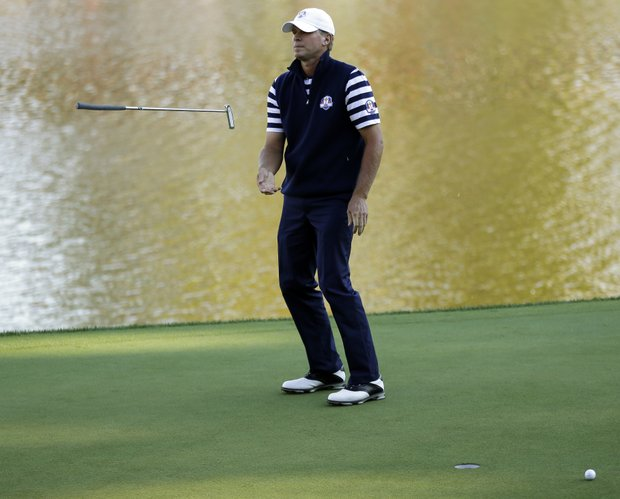 USA's Steve Stricker flips his putter after missing a putt on the 17th hole during a singles match at the Ryder Cup PGA golf tournament Sunday, Sept. 30, 2012, at the Medinah Country Club in Medinah, Ill.