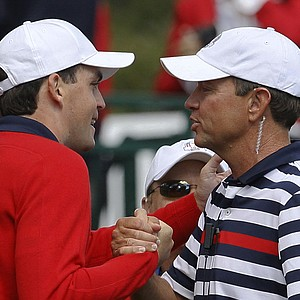 USA's captain Davis Love III, right, talks to Keegan Bradley on the first tee before a singles match at the Ryder Cup PGA golf tournament Sunday, Sept. 30, 2012, at the Medinah Country Club in Medinah, Ill.