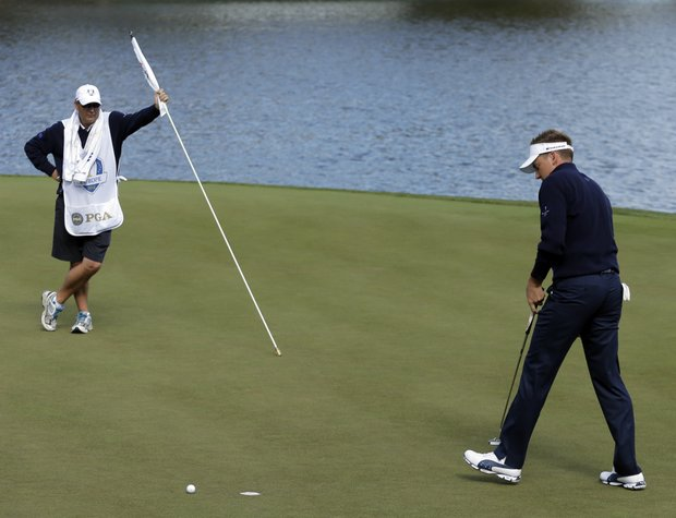 Europe's Ian Poulter reacts after missing a putt and losing the second hole to USA's Webb Simpson during a singles match at the Ryder Cup PGA golf tournament Sunday, Sept. 30, 2012, at the Medinah Country Club in Medinah, Ill.