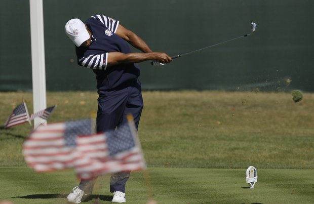 USA's Tiger Woods hits a drive on the second hole during a singles match at the Ryder Cup PGA golf tournament Sunday, Sept. 30, 2012, at the Medinah Country Club in Medinah, Ill.