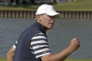 USA's Steve Stricker reacts after winning the second hole during a singles match at the Ryder Cup PGA golf tournament Sunday, Sept. 30, 2012, at the Medinah Country Club in Medinah, Ill.