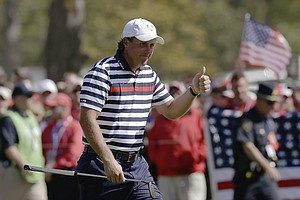 USA's Phil Mickelson gives a thumbs up as he walks up the third hole during a singles match at the Ryder Cup PGA golf tournament Sunday, Sept. 30, 2012, at the Medinah Country Club in Medinah, Ill.