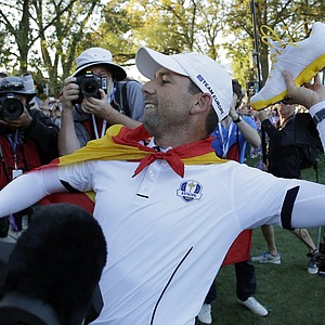 Europe's Sergio Garcia throws his shoes to fans after winning the Ryder Cup PGA golf tournament Sunday, Sept. 30, 2012, at the Medinah Country Club in Medinah, Ill.