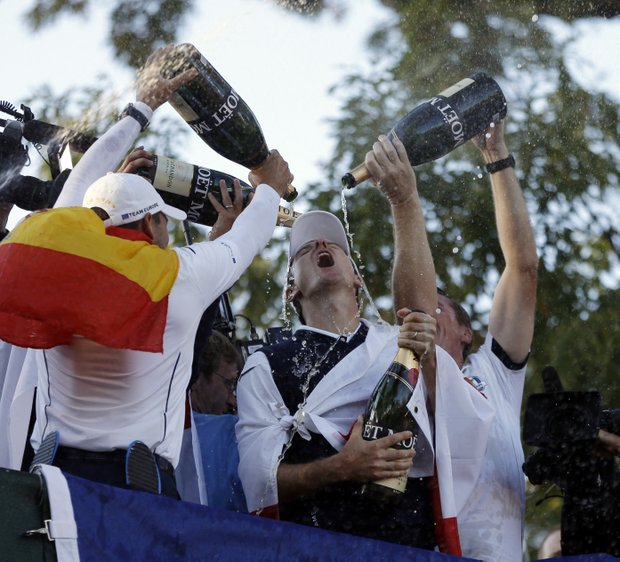 Players pour Champagne on Europe's Justin Rose as the celebrate after winning the Ryder Cup PGA golf tournament Sunday, Sept. 30, 2012, at the Medinah Country Club in Medinah, Ill.