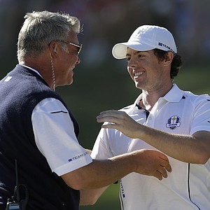 Darren Clarke congratulates Europe's Rory McIlroy after winning his singles match against USA's Keegan Bradley at the Ryder Cup PGA golf tournament Sunday, Sept. 30, 2012, at the Medinah Country Club in Medinah, Ill.