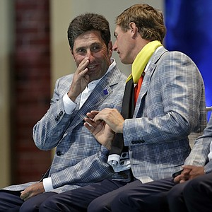 Europe's Nicolas Colsaerts, right, talks to team captain Jose Maria Olazabal at the closing ceremony for the Ryder Cup PGA golf tournament Sunday, Sept. 30, 2012, at the Medinah Country Club in Medinah, Ill.