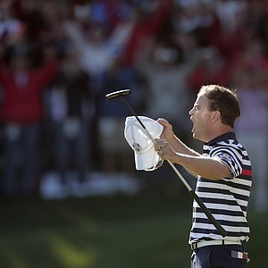 USA's Zach Johnson reacts after winning on the 17th hole during a singles match at the Ryder Cup PGA golf tournament Sunday, Sept. 30, 2012, at the Medinah Country Club in Medinah, Ill.