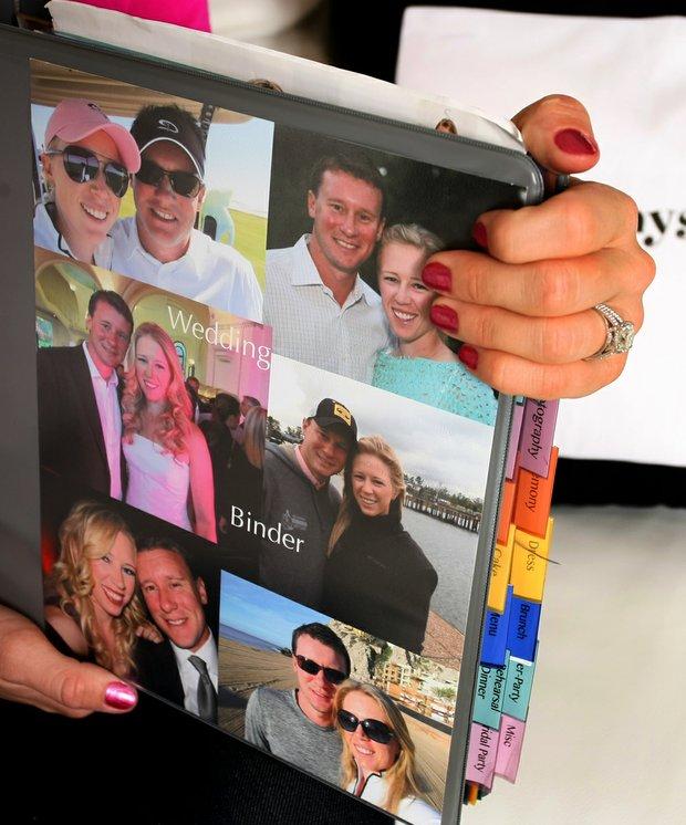 Morgan Pressel holds her wedding binder full of secret wedding details.