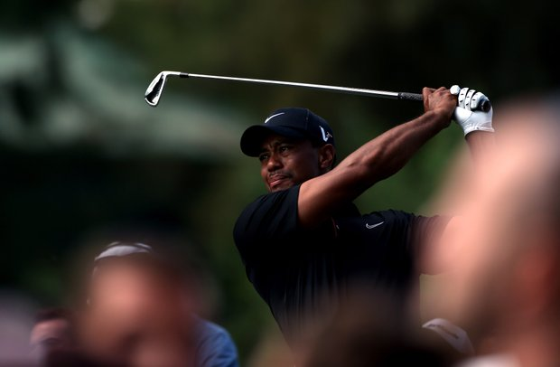 Tiger Woods tees off on the 15th hole against Charl Schwartzel during Day 1 of the Turkish Airlines World Golf Final.