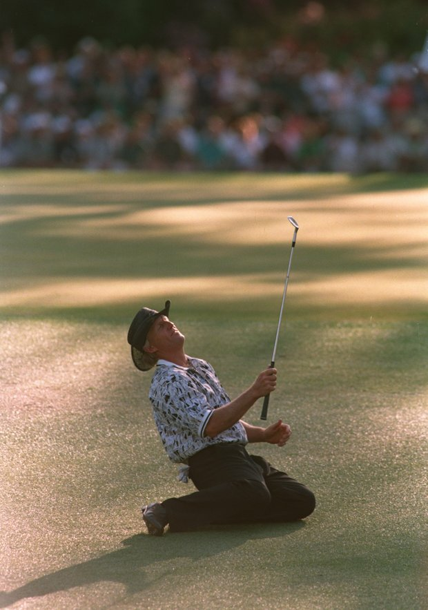 Greg Norman collapses on the ground after narrowly missing his chip shot on the 15th green during the final round of the 1996 Masters.