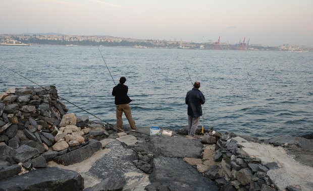 Fisherman on the Bosphorus in Istanbul, Turkey.