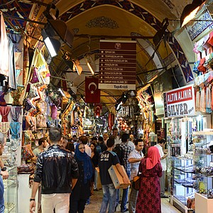 Inside the Grand Bazaar in Instanbul, Turkey. After the conquest of Istanbul by the Turks in 1453, the Grand Bazaar was built in 1461 to promote a more commercial life. The bazaar was an important center trading goods and gradually became a bank with a large depository of golden and silverware and money as well. The Grand Bazaar has 22 gates, 64 street, 3600 shops and is the center of trading for 97 different types of products.