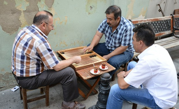 Backgammon is believed to have originated in Iran, not to far from Turkey.  It is a popular board game around Istanbul while merchants are passing the time away.