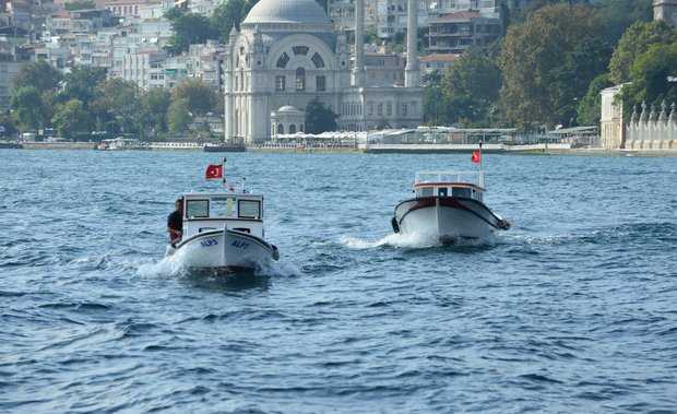 Typical scene of small boats on the Bosphorus in Istanbul, Turkey.