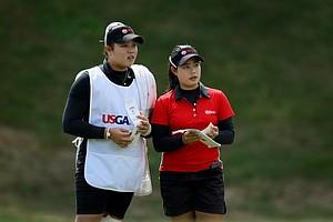 Moriya Jutanugarn, right, and her sister, Ariya during the Semifinals at the U. S. Women's Amateur Championship at Rhode Island Country Club.