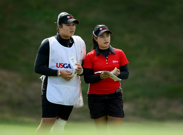 Moriya Jutanugarn, right, and her sister, Ariya during the Semifinals at the U. S. Women's Amateur Championship at Rhode Island Country Club.