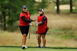 Ariya Jutanugarn, left, and her sister, Moriya, right, during the Round of 16 at the 112th U. S. Women's Amateur Championship.