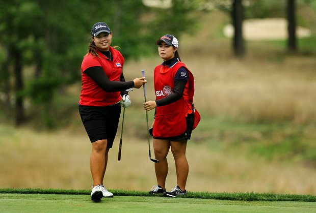 Ariya Jutanugarn, left, and her sister, Moriya, right, during the Round of 16 at the 112th U. S. Women's Amateur Championship.